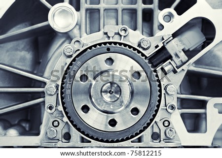 toned shot of a gear in a motor - stock photo