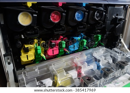 toner cartridges lined up inside the front panel of a photocopier - stock photo