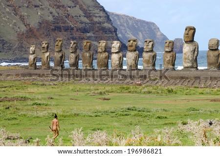 Tongariki Moais with Traditional Polynesian Man - Easter Island - stock photo