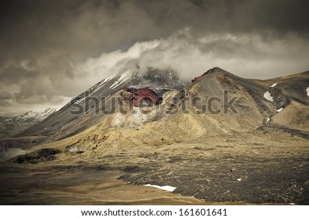 Tongariro Crossing, Red crater with Mt Ngauruhoe in background, New Zealand  - stock photo