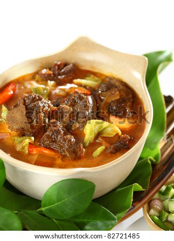 Tongseng, Indonesian style spicy curry stew with goat meat - stock photo