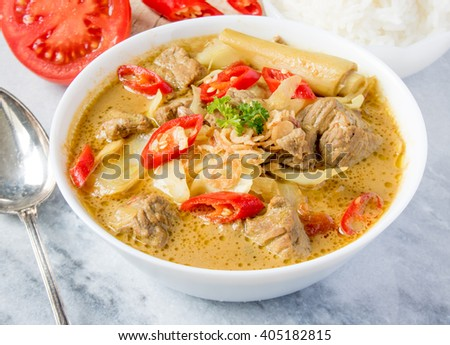 Tongseng Sapi , Indonesian style spicy curry stew with beef and vegetables - stock photo