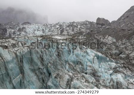 Tongue of Fox glacier in New Zealand - stock photo