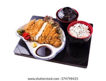 Tonkatsu - Japanese breaded, deep-fried pork cutlet on top of boiled rice served with shredded cabbage and curry sauce. (clipping path) - stock photo
