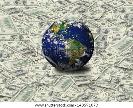Tons of 100 Dollars bank note spread on the floor and blue planet sit on it. Note: Earth Image from NASA (www.nasa.gov) - stock photo