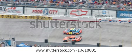 Tony Stewart & Jeff Gordon racing hard during the Food City 500 at Bristol TN on march 16th 2008. - stock photo