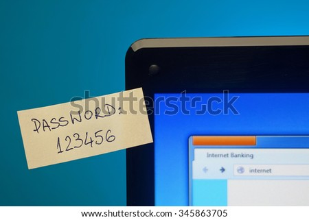 Too easy password on sticky notes on laptop screen. Focus on password - stock photo
