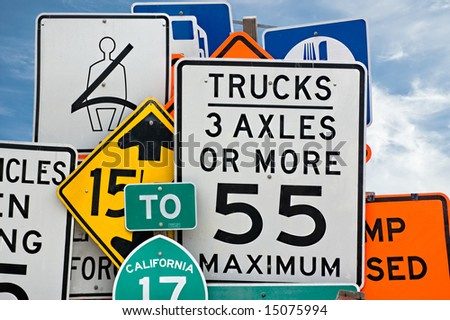 Too much information. A collection of various highway signs - stock photo