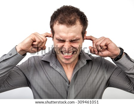 Too much noise or pressure concept - man covering ears for some silence - stock photo