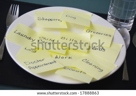 Too much on your plate - stock photo