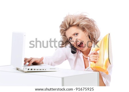 Too much work and stress / Woman like businesswoman and housewife at the same time with laptop, phone and steam iron screaming - stock photo