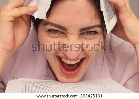 Too much work  (psychological portrait, aggression, anger, frustration) - stock photo