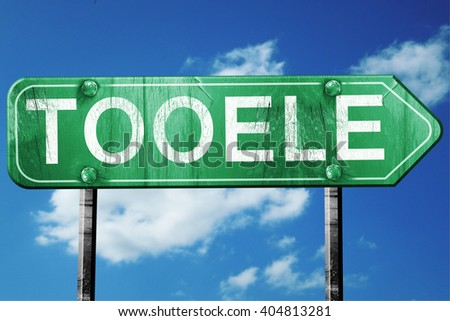 tooele road sign , worn and damaged look