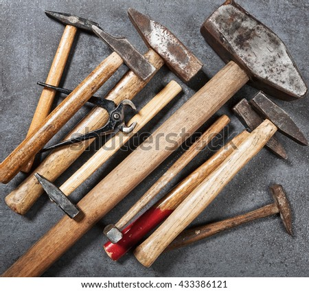 Tool background. Old vintage hammer and pincers tools collection on wooden workbench. Copy space. Top view, flat lay - stock photo