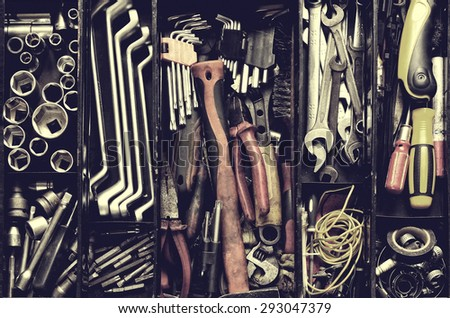 Tool box. Toolset with interior compartments to keep wrenches, ring spanners, hammer, pliers, screwdrivers, monkey wrenches, screws, bolts, wire and other do-it-yourself (DIY) tools. - stock photo