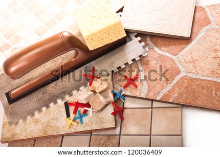 Tool for the installation of ceramic tile and tile of different types - stock photo