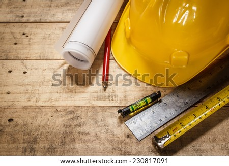 tool renovation on brown wood background - stock photo