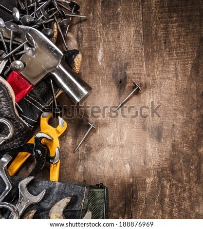 tool renovation on grunge wood background