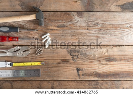 Tool renovation on wood background with space for copy.