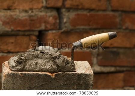 Tool   shovel   glue    cement - stock photo