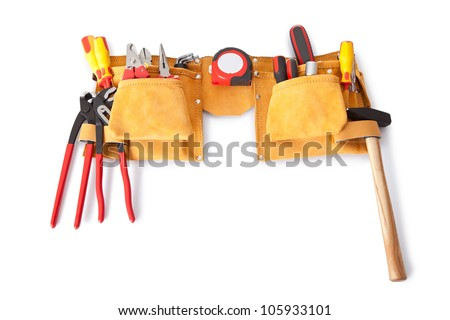 Toolbelt with various tools lying on the bench - stock photo