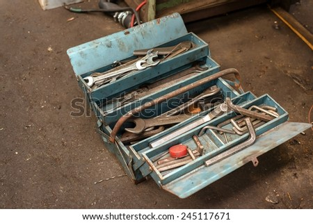 Toolkit of various tools in the box - stock photo