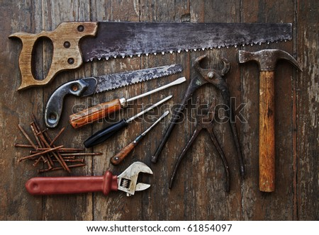 tools against wooden wall - stock photo