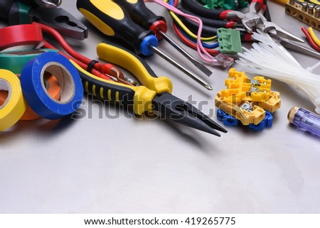 Tools and accessories used in electrical installations - stock photo