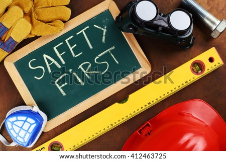tools and board with the inscription SAFETY FIRST