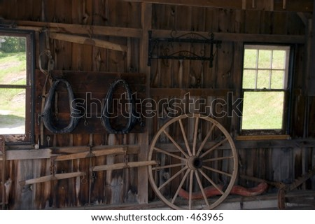 tools and equipment inside barn - stock photo