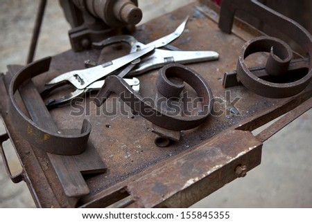 Tools and metal in an ironworks shop