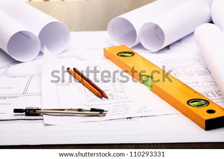 Tools and papers with sketches on the table - stock photo