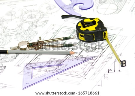 Tools and papers with sketches on the table. technical drawings. - stock photo