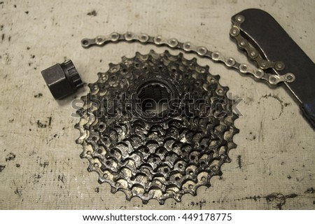 tools and parts for the repair of a bicycle in the workshop - stock photo