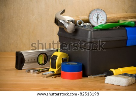 tools and toolbox on wood texture - stock photo