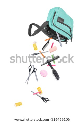 tools for beauty salon falling out of the bag isolated on white - stock photo