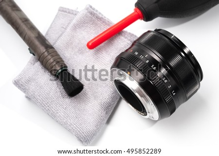 Tools for cleaning camera with lens isolated on white background.