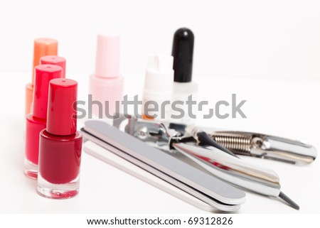 Tools for manicure, a varnish, pincers and a file