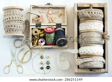 Tools for needlework, thread for sewing, scissors, buttons and vintage laces - stock photo