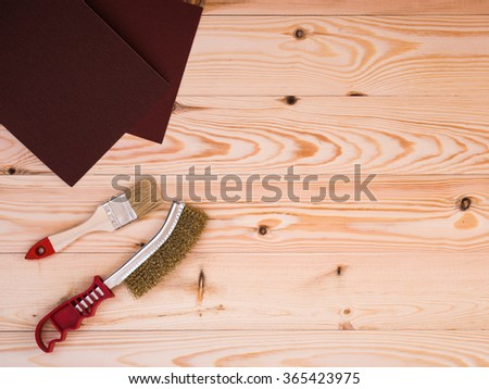 tools for painting and repair on wood background - stock photo