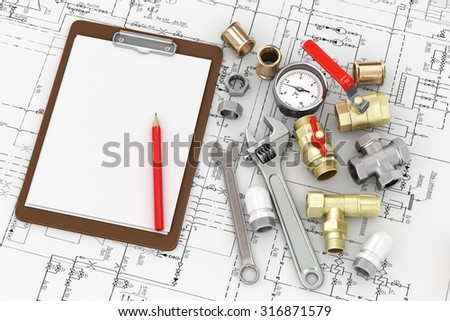 Tools for repair plumbing with empty leaf to write the text on the drawing. - stock photo