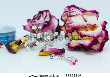 Tools for sewing and dried roses