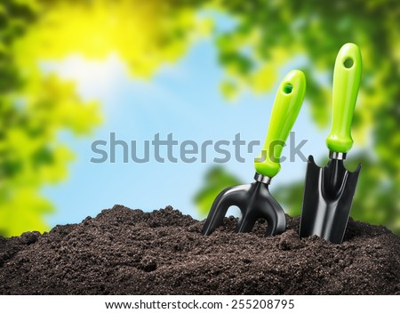 tools garden soil on nature background. Focus on tools - stock photo