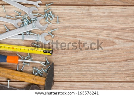 tools kit border on wooden  parquet planks with copy space - stock photo