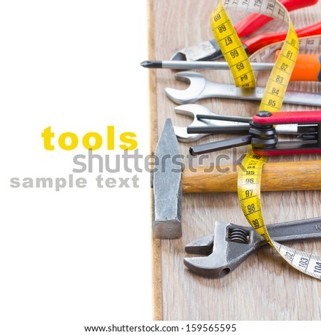 tools kit on parquet plank - stock photo