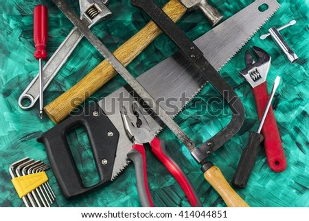 Tools lying on a green background - stock photo