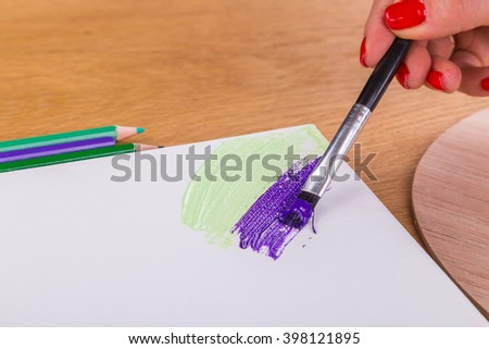 Tools of the artist. Drawing, preparation for painting. Drawing tools on a wooden background. - stock photo