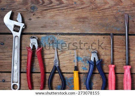 Tools on a timber floor, the top view - stock photo