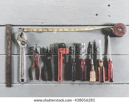 tools on the wood table with wrench tool, screwdriver, ruler and pliers - stock photo