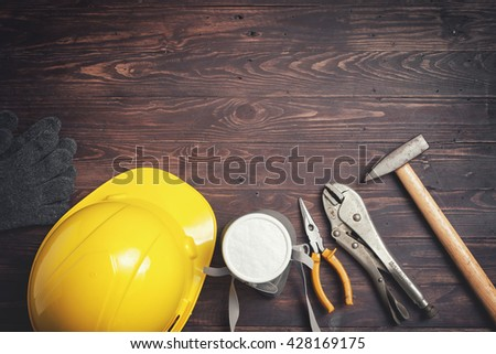 tools on wooden background.